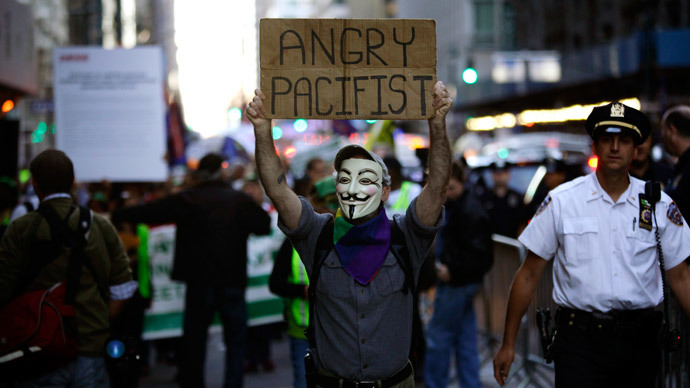 A Occupy Wall Street protester marches along Madison Avenue in New York.(Reuters / Joshua Lott)