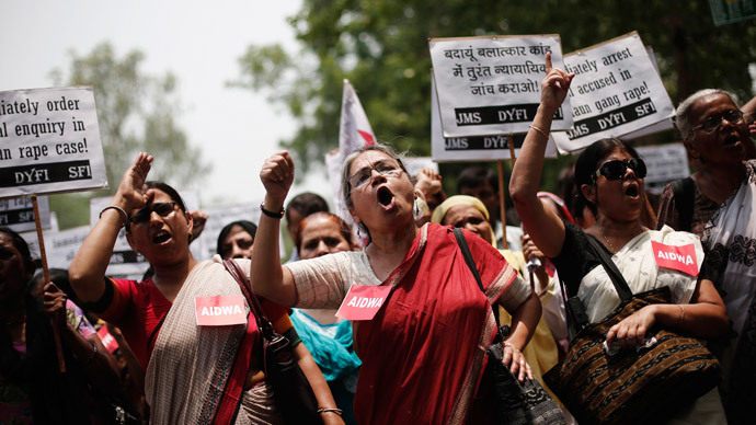 Demonstrators from All India Democratic Women's Association (AIDWA) hold placards and shout slogans during a protest against the recent killings of two teenage girls, in New Delhi May 31, 2014.(Reuters / Adnan Abidi)