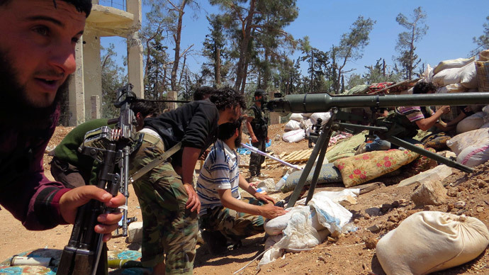 Free Syrian Army fighters prepare to fire.(Reuters / Stringer)