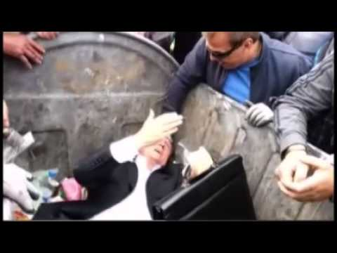 NOW, HERE'S AN IDEA! WATCH AS UKRAINIANS THROW POLITICIAN IN A DUMPSTER