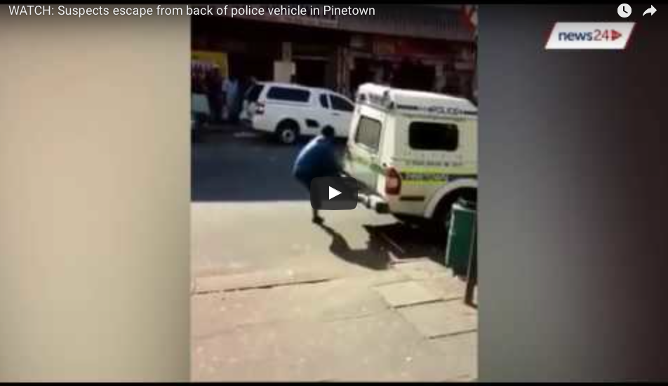 [WATCH] Suspects Escape From Police Van, And What Was That Mystery Man Doing?