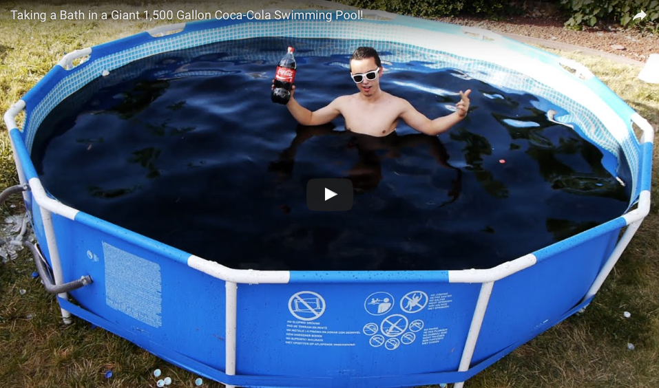 Watch taking a bath in a giant 1 500 gallon coca cola How many gallons in an average swimming pool