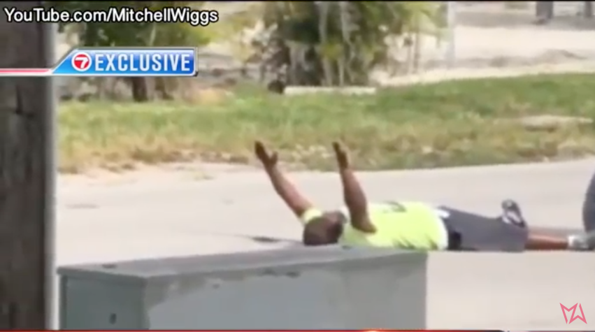 SHOCKING VIDEO: Caretaker Of Autistic Man Shot By Cops As He Lay With His Hands Up