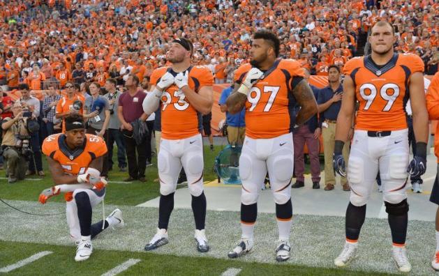 Denver Broncos inside linebacker Brandon Marshall (54) kneels during the national anthem.