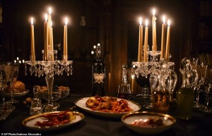 In this picture taken Oct. 9, 2016, a candlelight dinner is set up before a photo shoot, in Bran Castle, in Bran, Romania. Airbnb has launched a contest to find two people to stay overnight in the castle on Halloween, popularly known as Dracula's castle because of its connection to the cruel real-life prince Vlad the Impaler, who inspired the legend of Dracula. (AP Photo/Andreea Alexandru)