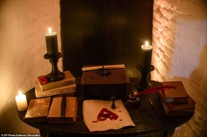 In this picture taken Oct. 9, 2016, candles and books are arranged on a table before a photo shoot of a room in Bran Castle, in Bran, Romania. Airbnb has launched a contest to find two people to stay overnight in the castle on Halloween, popularly known as Dracula's castle because of its connection to the cruel real-life prince Vlad the Impaler, who inspired the legend of Dracula. (AP Photo/Andreea Alexandru)