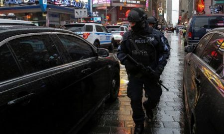 members-of-the-nypds-counterterrorism-bureau-patrol-times-square-in-the-lead-up-to-new-years-celeb