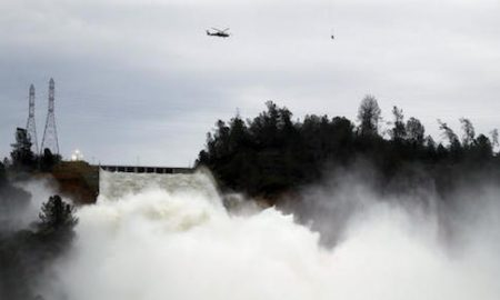Water gushes down the Oroville Dam's main spillway Wednesday, Feb. 15, 2017, in Oroville, Calif. The Oroville Reservoir is continuing to drain Wednesday as state water officials scrambled to reduce the lake's level ahead of impending storms. (AP Photo/Marcio Jose Sanchez)