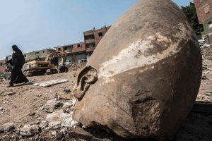 26-foot statue submerged in ground water in a Cairo slum