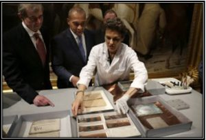 Pam Hatchfield, head of objects conservation at Boston's Museum of Fine Arts, displays objects removed from a time capsule in Boston.