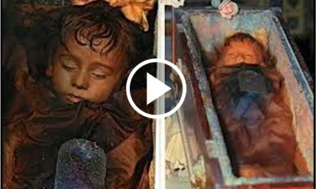 Rosalia is lying in a glass coffin, and placed inside the Capuchin Catacombs in Palermo, Italy
