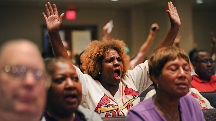 Residents shout out during the Ferguson city council meeting on September 9, 2014 in Ferguson, Missouri. (AFP Photo/Scott Olson)