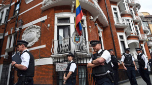 Police stand guard during a news conference by WikiLeaks founder Julian Assange at the Ecuadorian embassy in central London August 18, 2014.(Reuters / Toby Melville)