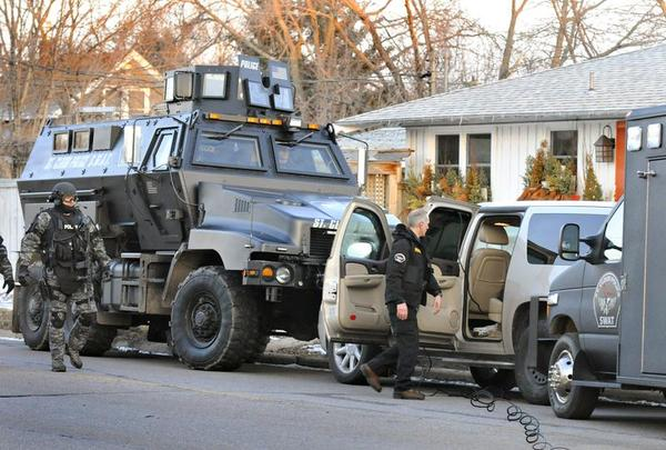 In this April 1, 2014 photo, police use a military-grade vehicle during a standoff in St. Cloud, Minn. (AP Photo/The St. Cloud Times, Jason Wachter)