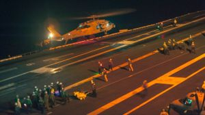 This photo provided by the US Navy, a MH-60S Sea Hawk helicopter lands on the flight deck of the Nimitz-class aircraft carrier USS Carl Vinson (CVN 70) during search and rescue operations for a missing pilot on Friday, Sept. 12, 2014.  (Photo credit: AP)