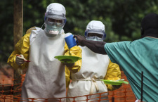 Medical staff working with Medecins sans Frontieres (MSF) prepare to bring food to patients kept in an isolation area at the MSF Ebola treatment centre in Kailahun July 20, 2014. (Reuters/Tommy Trenchard)