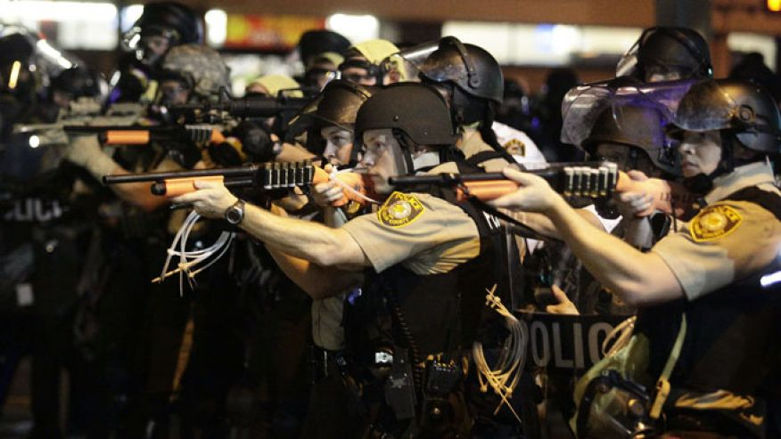 Aug 18, 2014: Police officers point their weapons at demonstrators protesting against the shooting death of Michael Brown in Ferguson, Missouri. (Reuters)