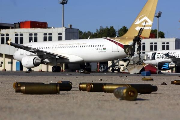 A picture taken on August 26, 2014, shows bullet casing and damaged airplanes on the tarmac at Tripoli international airport in the Libyan capital after fighters from the Fajr Libya (Libyan Dawn) coalition captured the airport from Zintan force, allies of rogue general Khalifa Haftar. AFP PHOTO/MAHMUD TURKIA MAHMUD TURKIA/AFP/Getty Images