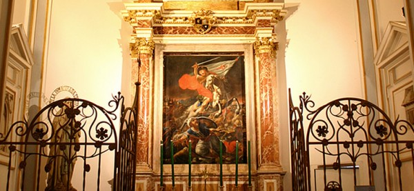 """A Spanish mural of St. James the Apostle, patron saint of Spain, beheading a Muslim in battle. St. James is sometimes called Matamoros, which means """"Muslim killer."""" From the Cathedral website: """"It is said that in 844, King Ramiro I had a battle in Clavijo, where he defeated the Muslims, with the help of the appearance of the apostle riding a white horse, as it is represented in the painting of this chapel."""" The mural is located in the St. James chapel at at St. Mary's Cathedral, Valencia, Spain – the same church from which St. Juan de Ribera directed the end of Spanish Islam in 1609."""