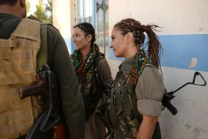 Zekia Karhan, 26, front-left, and Felice Budak, 24, back-middle, speak with a journalist in Makhmur, Iraq, Aug. 23, 2014. Karhan and Budak are guerrillas in the Kurdistan Workers' Party. JOSHUA L. DEMOTTS/STARS AND STRIPES