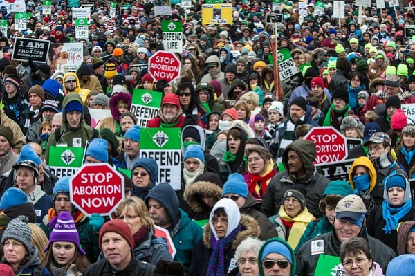 WASHINGTON, DC - JANUARY 25: Anti-abortion protesters attend the March for Life on January 25, 2013 in Washington, DC. The pro-life gathering is held each year around the anniversary of the Roe v. Wade Supreme Court decision. Credit: Getty Images