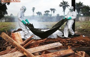 Burial Team Prepares A Dead Ebola Victim For Cremation In Monrovia