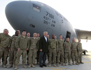 U.S. Secretary of Defense Chuck Hagel poses for a picture with U.S. Army troops on the tarmac of Kabul airport, March 11, 2013, before boarding a flight to Washington. Hagel ended his three day visit to Afghanistan on Monday, his first as Secretary of Defense.  (Reuters/Jason Reed)