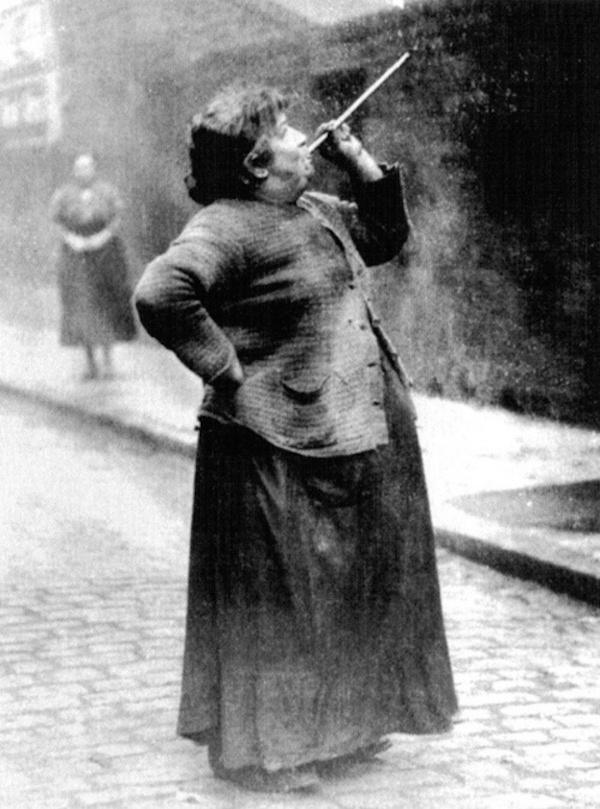"""3. Alarm clocks have become a part of our everyday routine in the modern world. But what did people do before them? They had people like this lady here, Mary Smith, who was known as a """"knocker upper"""". Her job was to go around every morning and shoot dried peas at people's windows in order to wake them up for work."""