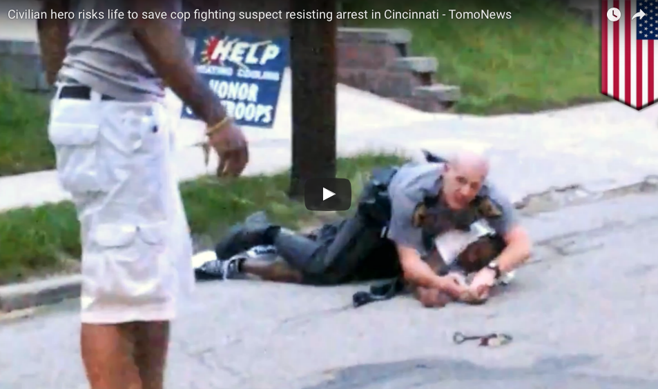 [VIDEO] Civilian Hero Risks Life To Save Struggling Cop Caught In A Fight