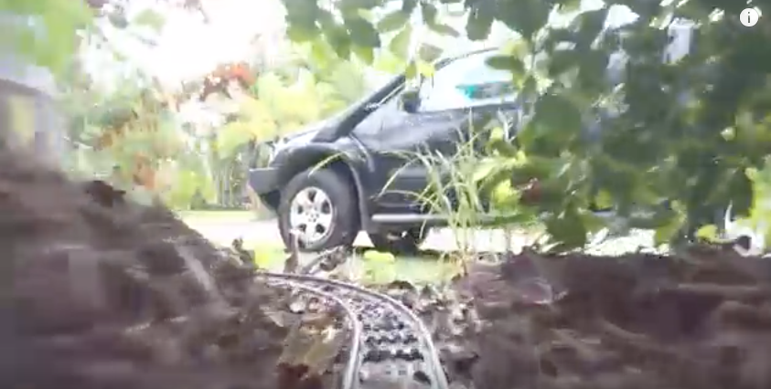 Old Meets New In Large Lego GoPro Train Set That Runs Through House And Garden