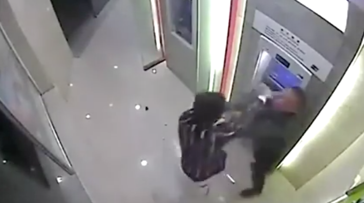 [WATCH] Robber Chooses THE WRONG VICTIM In Enclosed ATM Lobby