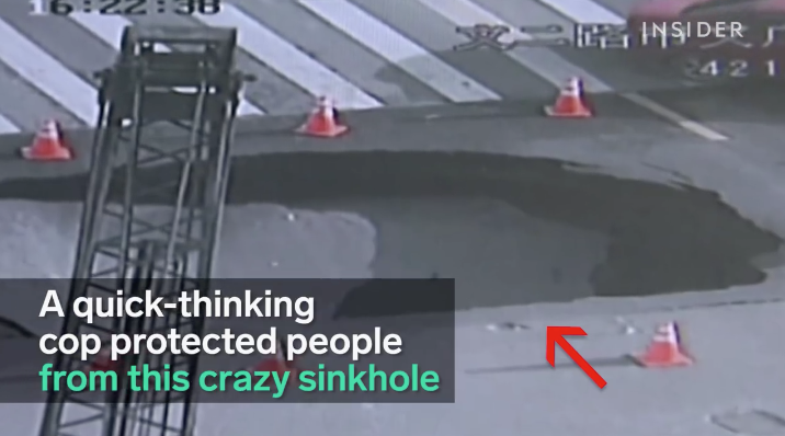 WATCH A Crazy Sinkhole Almost Swallow A Cop Who Ends Up Saving Everyone