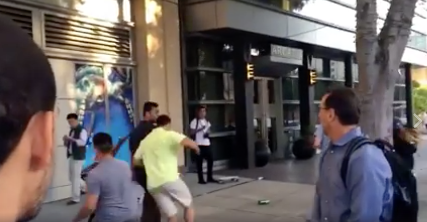 [WATCH] Donald Trump Supporter Gets Hit With A Bag Of Rocks From Behind