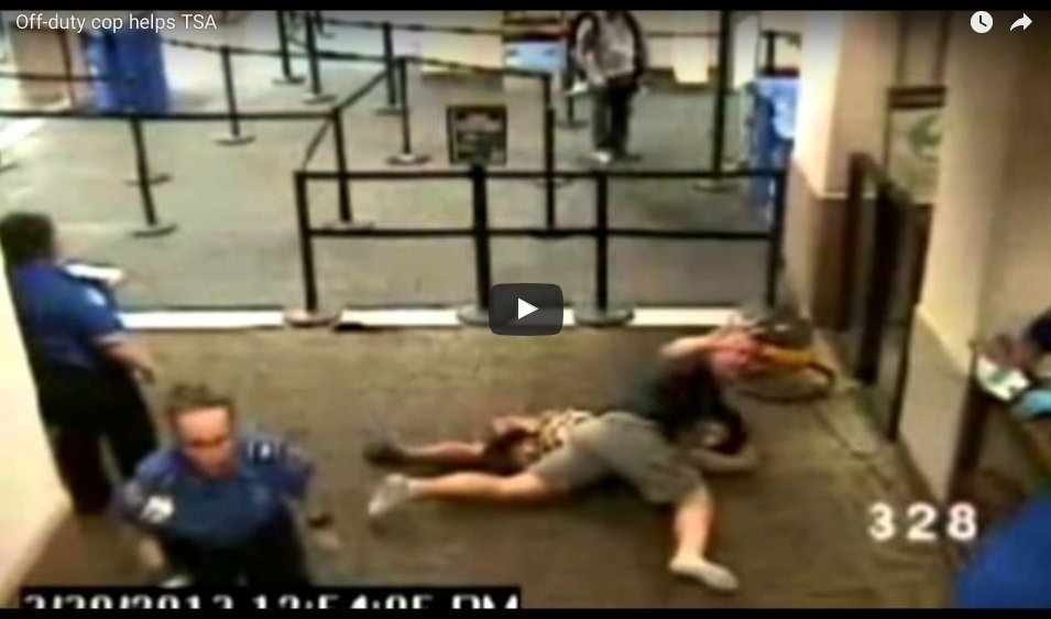 [WATCH] TSA Agent Gets Overwhelmed By Large Female Intruder, Off-Duty Cop Brings The Pain