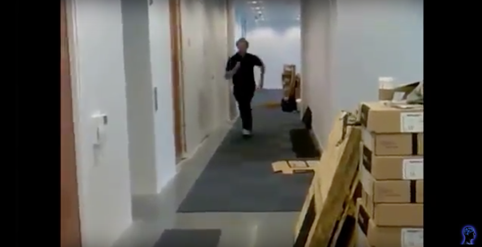 Man Tries to Slide Across Tiles In Office Hallway And Meets A Nasty Surprise