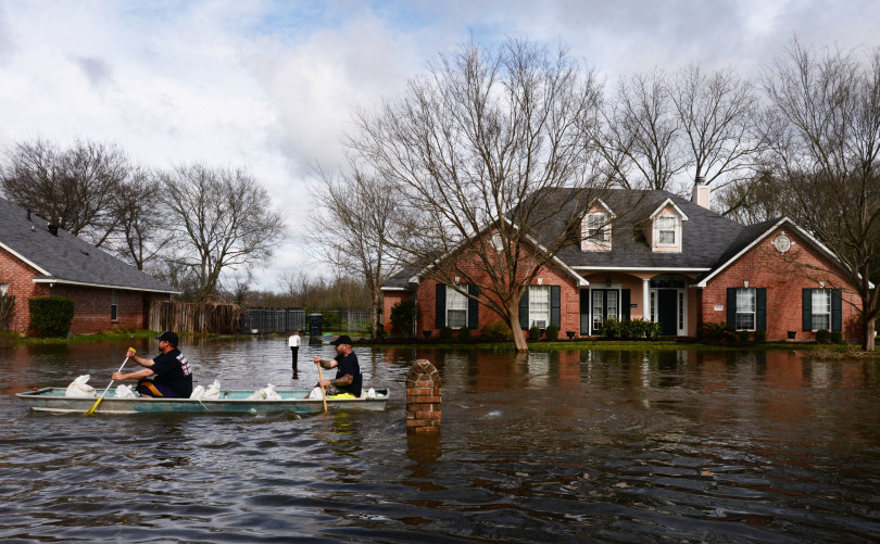 Firefighters boat into Golden Meadows subdivision to see if anyone needs help in floodwaters in Bossier Parish, La., Thursday, March 10, 2016. (Henrietta Wildsmith/The Shreveport Times via AP) MANDATORY CREDIT