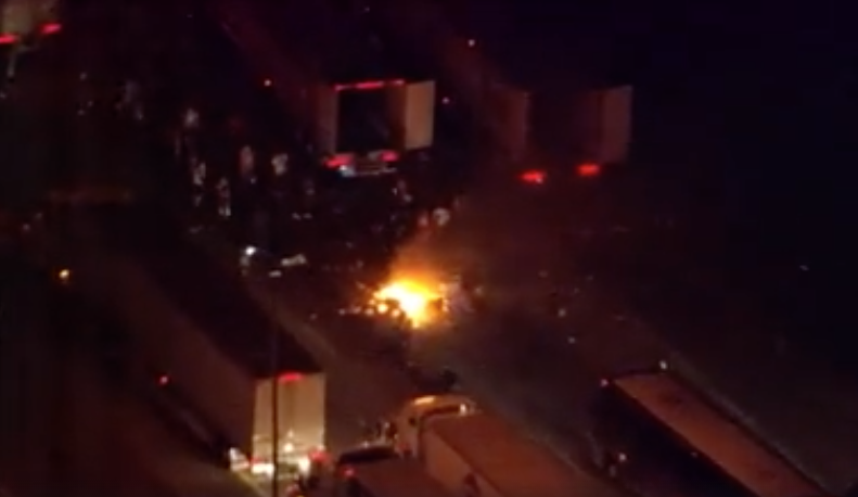 [VIDEO] Terrified Driver Stuck In Her Semi As It Was Looted And Burned